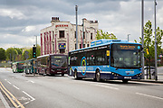 Electric buses in Nottingham City centre outside former Queen's Hotel on Arkwright Street, Nottingham, Nottinghamshire, United Kingdom. The council began charging companies who had over 11 parking spaces in attempt to get commuters to travel to work in more eco-friendly ways.<br /> (photo by Andrew Aitchison / In pictures via Getty Images)