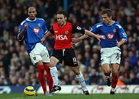 Photo. Daniel Hambury.<br /> Portsmouth v Blackburn Rovers. 15/1/2005.<br /> Barclays Premiership.<br /> Portsmouth's Gary O'Neil cant stop Blackburn's Paul Dickov.