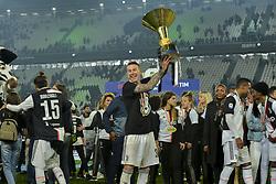 May 19, 2019 - Turin, Turin, Italy - Federico Bernardeschi of Juventus FC lifts the trophy of Scudetto  2018-2019 at Allianz Stadium, Turin (Credit Image: © Antonio Polia/Pacific Press via ZUMA Wire)