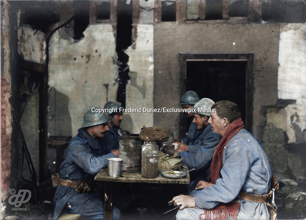 """Colorized photographs soldiers from the World War One<br /> <br /> With his impressive colorized photographs of the World War One, Frédéric Duriez gives us a new look at the conflict that ravaged the world between 1914 and 1918, revealing the difficult daily life of the French soldiers. <br /> <br /> Photo Shows: """" Neuvilly , 7 December 1915. """"""""La soupe"""""""" in the Police station. The uniforms are dirty because during this period of incessant rains ( for 6 days) overwhelmed their trenches .<br /> ©Frédéric Duriez/Exclusivepix Media"""