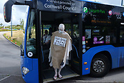 """Extinction Rebellion Penitents on the bus into Truro to protest for climate change at Truro Cathedral in Cornwall at 11am on the 28th of August 2020 in Truro, United Kingdom. Based on the medieval idea of repenting transgressions against your community by wearing sackcloth and ashes whilst bearing your """"sins"""" around your neck. The Penitents performed in total silence in this highly visual ceremony. Starting at the Truro Park and Ride they travelled into Truro and walked in procession through the town before carrying out the ceremony. These protests are highlighting that the government is not doing enough to avoid catastrophic climate change and to demand the government take radical action to save the planet.<br /> <br /> Extinction Rebellion is a climate change group started in 2018 and has gained a huge following of people committed to peaceful protests. These protests are highlighting that the government is not doing enough to avoid catastrophic climate change and to demand the government take radical action to save the planet."""