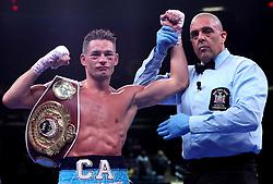 Chris Algieri (left) celebrates winning the WBA International Super-Lightweight title belt at Madison Square Garden, New York.