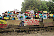 Blockades against the Baram Dam have been a huge success, after years of campaigning and protest, the  Baram Dam in Sarawak has now been shelved. Demonstration at blockade site. Baram Sarawak 2015<br /><br />The first of 12 mega-dam projects, was the Bakun Dam, which produced a reservoir of 700 sqkm, the size of Singapore, whose flooding began in 2010 and displaced around 10,000 Kenyah people, in Rajang and Belaga. The second phase at Murum would displace a further 24,000 native people, and Baram some 30,000. This huge development program has been overseen by Sarawak's former Chief Minister, Abdul Taib Mahmud, who is now under investigation by Malaysian authorities for corruption, and who has amassed a personal fortune of more than 35 billion US dollars. <br /><br />Borneo native peoples and their rainforest habitat revisited two decades later: 1989/1991 and 2012/2014/2015. <br /> <br /> Sarawak's primary rainforests have been systematically logged over decades, threatening the sustainable lifestyle of its indigenous peoples who relied on nomadic hunter-gathering and rotational slash & burn cultivation of small areas of forest to survive. Now only a few areas of pristine rainforest remain; for the Dayaks and Penan this spells disaster, a rapidly disappearing way of life, forced re-settlement, many becoming wage-slaves. Large and medium size tree trunks have been sawn down and dragged out by bulldozers, leaving destruction in their midst, and for the most part a primary rainforest ecosystem beyond repair. Nowadays palm oil plantations and hydro-electric dam projects cover hundreds of thousands of hectares of what was the world's oldest rainforest ecosystem which had some of the highest rates of flora and fauna endemism, species found there and nowhere else on Earth, and this deforestation has done irreparable ecological damage to that region