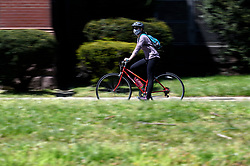 Cyclists with face mask rides along the Schuylkill River in Philadelphia, PA, on April 28, 2020. Despite the state-wide stay-at-home order still in effect, spring weather draws hundreds to exercise outdoors.