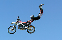 """Jul 01, 2003; Anaheim, California, USA; Moto X star athlete ROBERT DISTLER executing a tremendous stunt hands & feet free flying through the air with a full sized motobike at the opening of Disney's California Adventure """"X Games Experience"""".  Disney park has built two X-Arena's specifically for this 41 day event highlighting extreme sports for the launch of the 2003 ESPN X Games.<br />Mandatory Credit: Photo by Shelly Castellano/Icon SMI<br />(©) Copyright 2003 by Shelly Castellano"""