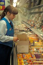 Trainee shelf filler in Farmfoods supermarket UK