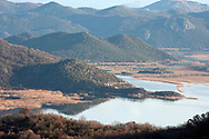 Looking towards Biški rep (the slender spit of land in the centre of the picture), which was the proposed development site of Porto Skadar, a project successfully opposed by local and international environmental groups. Lake Skadar National Park, Montenegro © Rudolf Abraham