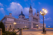 """Almudena Cathedral (Santa María la Real de La Almudena) is a Catholic church in Madrid, Spain. It is the seat of the Roman Catholic Archdiocese of Madrid. The cathedral was consecrated by Pope John Paul II in 1993. When the capital of Spain was transferred from Toledo to Madrid in 1561, the seat of the Church in Spain remained in Toledo and the new capital had no cathedral. Plans to build a cathedral in Madrid dedicated to the Virgin of Almudena were discussed as early as the 16th century but even though Spain built more than 40 cities in the new world during that century and plenty of cathedrals, the cost of expanding and keeping the Empire came first and the construction of Madrid's cathedral was postponed. Making the cathedral the largest that the world had ever seen was then a priority. All other main Spanish cities had centuries old cathedrals, and Madrid also has old churches, but the construction of Almudena only began in 1879. The cathedral seems to have been built on the site of a medieval mosque that was destroyed in 1083 when Alfonso VI reconquered Madrid.<br /> <br /> Francisco de Cubas, the Marquis of Cubas, designed and directed the construction in a Gothic revival style. Construction ceased completely during the Spanish Civil War, and the project was abandoned until 1950, when Fernando Chueca Goitia [es] adapted the plans of de Cubas to a baroque exterior to match the grey and white façade of the Palacio Real, which stands directly opposite.<br /> <br /> The cathedral was not completed until 1993, when it was consecrated by Pope John Paul II.<br /> <br /> On 22 May 2004 the marriage of King Felipe VI, then crown prince, to Letizia Ortiz Rocasolano took place at the cathedral.<br /> <br /> The Neo-Gothic interior is uniquely modern, with chapels and statues of contemporary artists, in heterogeneous styles, from historical revivals to """"pop-art"""" decor. The Blessed Sacrament Chapel features mosaic from known artist Fr. Marko Ivan Rupnik. The paintings in """