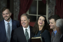 January 3, 2018 - Washington, District Of Columbia, U.S. - United States Senator DOUG JONES, Democrat of Alabama, 2nd from left, with his son Carson, left, wife Louise, center, and son Christoper, right, during a ceremonial swearing in at the United States Capitol. (Credit Image: © Alex Edelman via ZUMA Wire)