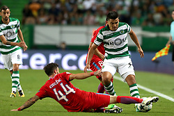 August 15, 2017 - Lisbon, Portugal - Sporting's midfielder Marcos Acuna from Argentina vies with Steaua's midfielder Gabriel Enache (L) during the UEFA Champions League play-offs first leg football match between Sporting CP and FC Steaua Bucuresti at the Alvalade stadium in Lisbon, Portugal on August 15, 2017. (Credit Image: © Pedro Fiuza/NurPhoto via ZUMA Press)