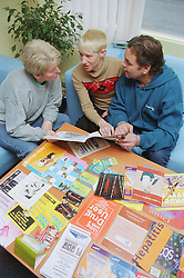 Project manager discussing magazine about health issues with two clients,