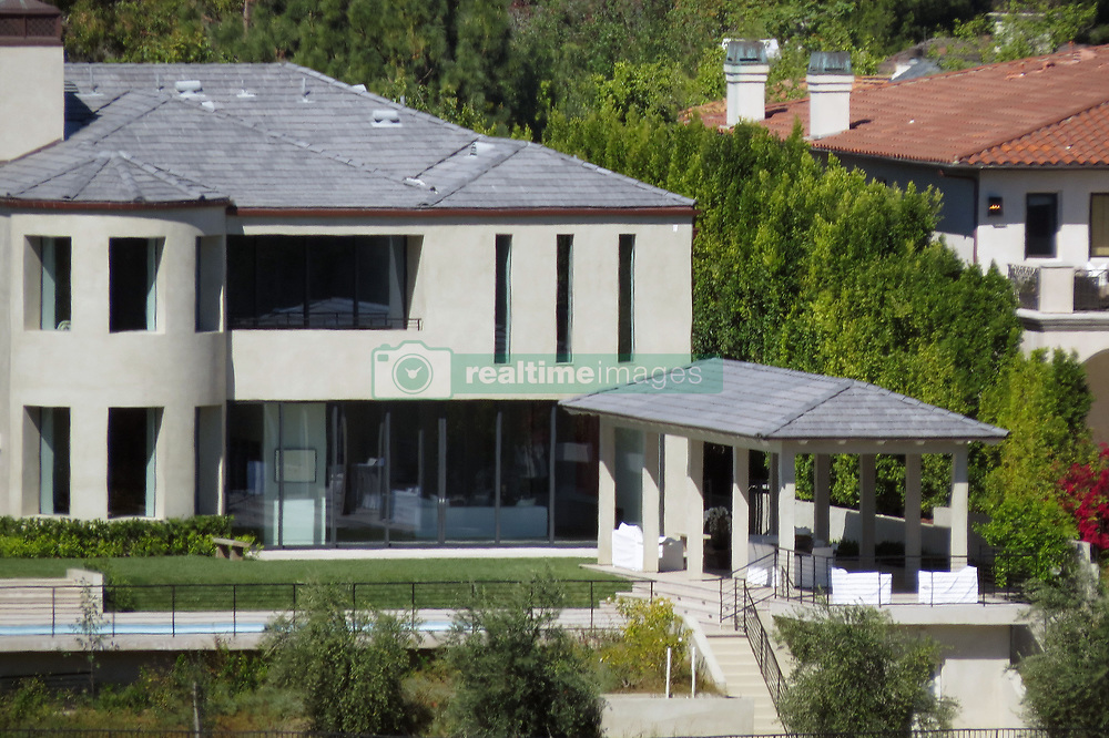 The 1-acre property boast 10,000-square-feet of luxury living! Kimye purchased the house back in 2013 for $9 million and sold the Bel Air mansion which has Canyon views for a whopping $17.8 million. Kim, 37 and 40-year-old Kanye never lived in the property and spent almost 4 years renovating the property at a cost of around $2 million. The house sits in an exclusive gated neigborood of Los Angeles with celebrity neighbors including Gordon Ramsay. 14 Nov 2017 Pictured: Kim Kardashian Kanye West House GV. Photo credit: MEGA TheMegaAgency.com +1 888 505 6342