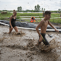 Competitors participate the Brutal Run 7 km extreme obstacle course race in Nyaregyhaza, Hungary on July 18, 2020. ATTILA VOLGYI