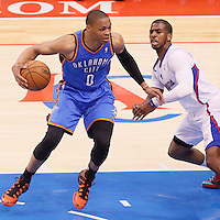 11 May 2014: Oklahoma City Thunder guard Russell Westbrook (0) drives past Los Angeles Clippers guard Chris Paul (3) during the Los Angeles Clippers 101-99 victory over the Oklahoma City Thunder, during Game Four of the Western Conference Semifinals of the NBA Playoffs, at the Staples Center, Los Angeles, California, USA.
