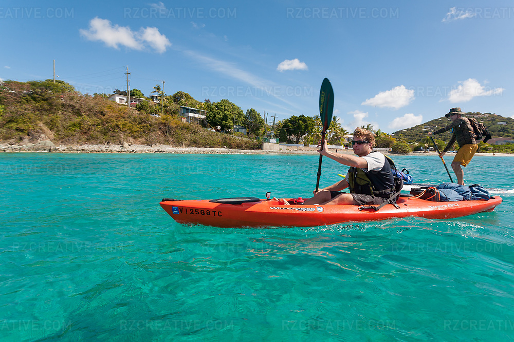 Standup paddler Ted Rutherford and Mark Anders paddle around Contant Point in St. John, U.S. Virgin Islands. © Robert Zaleski / rzcreative.com<br /> —<br /> To license this image contact: robert@rzcreative.com