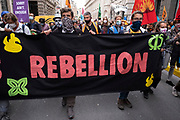 Marching for reparations at the Walk of Shame disruptive mach through the City of London by environmental group Extinction Rebellion on 4th September 2020 in London, United Kingdom. The walk visited various locations in the financial district, to protest against companies and institutions with historical links to the slave trade, or who finance or insure projects which are seen as ecologically unsound. The message by the group is that 'apologies and token attempts at diversity are not enough to address this legacy and present reality. Our demand is reparations and reparatory justice for those affected by colonial and neo-colonial exploitation'. Extinction Rebellion is a climate change group started in 2018 and has gained a huge following of people committed to peaceful protests. These protests are highlighting that the government is not doing enough to avoid catastrophic climate change and to demand the government take radical action to save the planet.