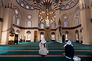 Japanese women cover their heads as they visit the Tokyo Camii Mosque in Yoyogi Uehara, Tokyo, Japan. Friday March 8th 2019 The Tokyo Camii most is the largest islamic place of worship in Japan. Current estimates put the Muslim population of japan at around 130,000.