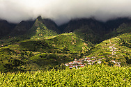 Dark clouds over the hills of Chao Dos Louros sunny village