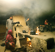 House of Nida Khan. Typical Wakhi interior, smoked up from the morning routine. Women will do lots of milk tea and flat bread called Non – House typically host between 15 and 30 people, so women will cook up to 30 large none bread for the whole day. The traditional life of the Wakhi people, in the Wakhan corridor, amongst the Pamir mountains.