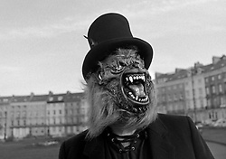© Licensed to London News Pictures.01/11/15<br /> Whitby, UK. <br /> <br /> A man wearing a werewolf mask poses for a picture at the Whitby Goth weekend in Whitby, North Yorkshire. The event began in 1994 to celebrate goth culture and music and takes place twice each year. <br /> Thousands of extravagantly dressed people attend the popular event wearing Steampunk, Cybergoth, Romanticism, Victoriana and other clothing as they take part in the celebration of Goth culture. <br /> <br /> Note to Editors - Picture shot on Kodak Tri X 400ISO film.<br /> Photo credit : Ian Forsyth/LNP