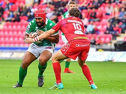 Epalahame Faiva of Benetton Treviso is tackled by Dan Jones of Scarlets<br /> <br /> Photographer Craig Thomas/Replay Images<br /> <br /> Guinness PRO14 Round 3 - Scarlets v Benetton Treviso - Saturday 15th September 2018 - Parc Y Scarlets - Llanelli<br /> <br /> World Copyright © Replay Images . All rights reserved. info@replayimages.co.uk - http://replayimages.co.uk