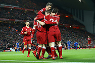Mohamed Salah of Liverpool (11) celebrates with his teammates after scoring his teams 2nd goal to make it 2-1. . Premier League match, Liverpool v Leicester City at the Anfield stadium in Liverpool, Merseyside on Saturday 30th December 2017.<br /> pic by Chris Stading, Andrew Orchard sports photography.