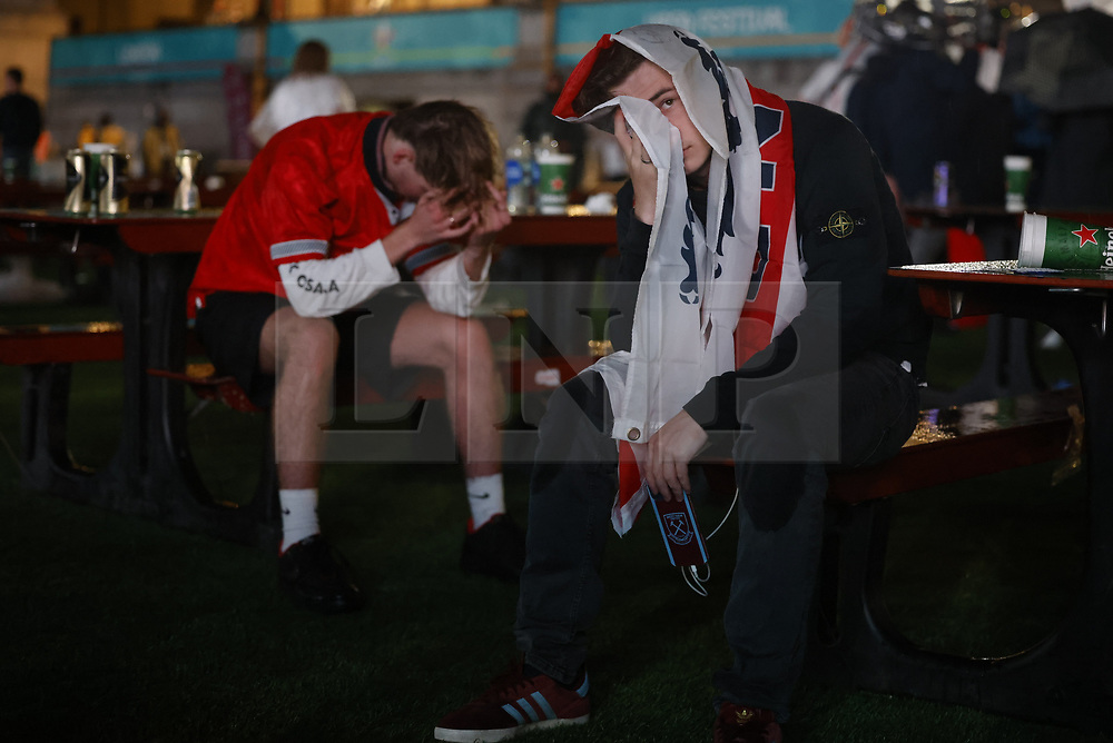 © Licensed to London News Pictures. 11/07/2021. London, UK. England supporters react to losing at the EURO 2020 final to Italy on penalties as they watch the giant screens in Tragalgar Square, central London. Photo credit: Peter Macdiarmid/LNP