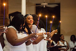 Graduate Jerice Lake.  Ten graduates of the University of the Virgin Islands School of Nursing commemorated their graduation with a pinning ceremony and lighting of candles while surrounded by nursing alumni, family, and friends.  University of the Virgin Islands School of Nursing 2015 Pinning Ceremony.  St. Thomas Reformed Church.  St. Thomas, VI.  12 May 2015.  © Aisha-Zakiya Boyd