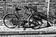 Abandoned bike in side road in China.