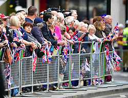 © Licensed to London News Pictures. 10/06/2016. London, UK. Members of the public gather outside St Paul's Cathedral for a service of thanksgiving to mark the 90th birthday of Queen Elizabeth II. Photo credit: Ben Cawthra/LNP