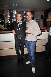 HUGO CHITTENDENand his mother LADY RATHCAVAN, at a screening of the short film 'The Volunteer' held at the Courthouse Hilton Hotel, 19-21 Great Marlborough Street, London W1 on 26th October 2009.