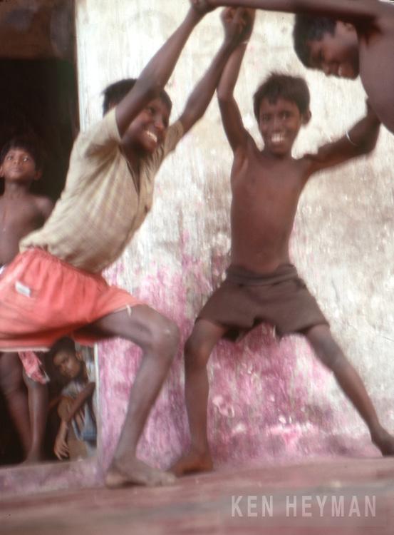 Calcutta, India, boys playing ball.