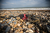 14/10/16. Sandwich Bay, Kent, UK. Discarded plastic products such as buckets, trays, crates and bottles remain stranded for years on the beach of Sandwich Bay in Kent, UK. Although most beach litter originates from beach visitors plastics from the fishing industry is still apparent. Credit line: Manu Palomeque