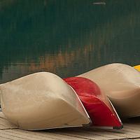 Canoes like on a dock beside Moraine Lake in Banff National Park, Alberta, Canada.