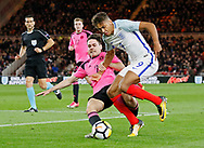 Dominic Calvert-Lewin of England is tackled by Liam Smith of Scotland during the U21 UEFA EURO first qualifying round match between England and Scotland at the Riverside Stadium, Middlesbrough, England on 6 October 2017. Photo by Paul Thompson.