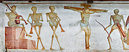 """Crucifiction fresco on the Church of San Vigilio in Pinzolo, part of its mural painting """"the Dance of Death"""" painted by Simone Baschenis of Averaria in1539, Pinzolo, Trentino, Italy.<br /> <br /> The mural continues for another 21 meters with a long procession with 40 figures. The Mural opens on its left with a skeleton on the throne, bearing a sceptre and the crown and playing a bagpipe. These skeletons are playing the music which is the backdrop to """"Dance of Death"""" ( Danza macabra ) and suggests that they are playing with our fate on earth.<br /> <br />  To the right of the skeletons playing music is a depiction of the crucification. Christ is depicted on the cross with an arrow in him that has been fired by a skeleton with a bow. This suggests that because Christ was a man he suffered the fate of death as we all will..<br /> <br /> Visit our MEDIEVAL ART PHOTO COLLECTIONS for more   photos  to download or buy as prints https://funkystock.photoshelter.com/gallery-collection/Medieval-Middle-Ages-Art-Artefacts-Antiquities-Pictures-Images-of/C0000YpKXiAHnG2k<br /> If you prefer to buy from our ALAMY PHOTO LIBRARY  Collection visit : https://www.alamy.com/portfolio/paul-williams-funkystock/san-vigilio-pinzolo-dance-of-death.html"""