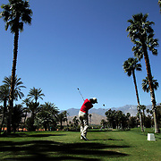A golfer tees off in Rancho Mirage, California.