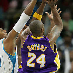 23 December 2008: Los Angeles Lakers guard Kobe Bryant (24) shoots over New Orleans Hornets forward David West (30) during a 100-87 loss by the New Orleans Hornets to the Los Angeles Lakers at the New Orleans Arena in New Orleans, LA. .