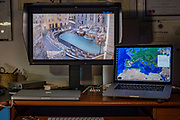 19 MAR 2020 - Workstation at home studio in Galliate (Piedmont - ITALY) overlooking webcam over Fontana di Trevi, Rome. Countries around the world are locking-down due to the Covid19 pandemic. At present, there are nearly 400k positive cases and more than 17k deaths.