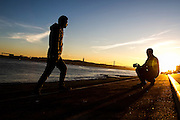 Boys take some pictures near Tagus River.<br /> Lisbon, Portugal