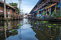DAMNOEN SADUAK, THAILAND - CIRCA SEPTEMBER 2014: Canals around the Damnoen Saduak floating market in the central region of Thailand.