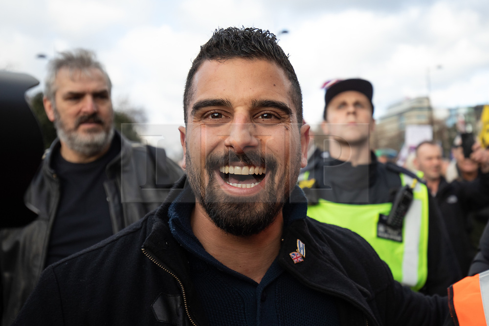 © Licensed to London News Pictures. 09/12/2018. London, UK. Far-right activist Avi Yemini joins demonstrators taking part in a 'Brexit Betrayal' march in central London, campaigning against Theresa May's Brexit deal. The demonstration is backed and attended by political activist Stephen Yaxley-Lennon, also known as Tommy Robinson. A counter demonstration organised by Unite Against Fascism and Racism is also taking place on a different route. Photo credit : Tom Nicholson/LNP