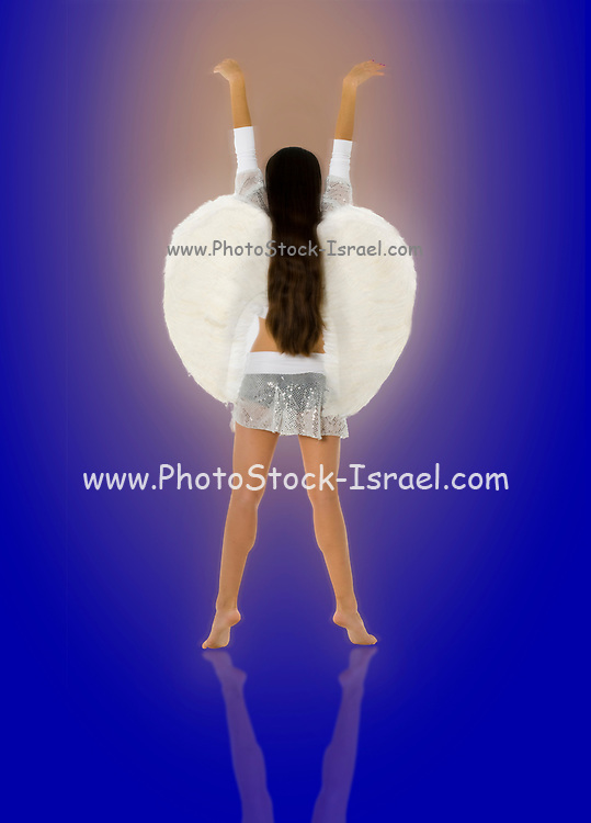 back view of an innocent angel On glowing blue Background