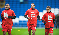CARDIFF, WALES - Saturday, November 14, 2009: Wales players warm-up wearing 'Show Racism the Red Card' before the international friendly match against Scotland at the Cardiff City Stadium. L-R: Jermaine Easter, captain Ashley Williams and Joe Allen. (Pic by David Rawcliffe/Propaganda)