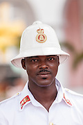 A member of the Royal Bahamas Police wearing a Wolseley pith helmet patrols Parliament Square Nassau, Bahamas.