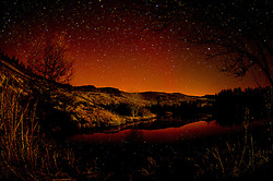 © London News Pictures. 07/03/2016 Nant yr Arian, Wales, UK. The spectacular sight of the Aurora Borealis - Northern Lights glowing in the night sky above Nant yr Arian forest park and lake, 10 miles inland from Aberystwyth. Photo credit: Keith Morris/LNP