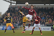 Northampton Town Striker Ricky Holmes leaps to clear  during the Sky Bet League 2 match between Northampton Town and Cambridge United at Sixfields Stadium, Northampton, England on 12 March 2016. Photo by Dennis Goodwin.