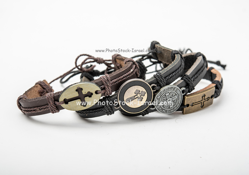 Christian souvenirs from the Holy Land leather bracelets on white background