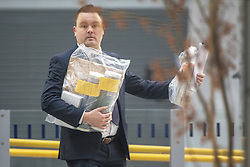 © Licensed to London News Pictures . FILE PICTURE DATED 01/01/2019 of evidence being carried from Victoria Station in Manchester as Mahdi Mohamud is due to appear at Manchester Crown Court today (Tuesday 26 November 2019) charged  with 3 counts of attempted murder and 1 count contrary to Section 58 (1) (a), TACT 2000 which relates to the possession of a document or record likely to be useful to a person committing or preparing an act of terrorism . On the evening of 31st December 2018 , as thousands headed in to Manchester City Centre to watch New Years Day fireworks , three people including a British Transport Police Officer were stabbed and a man was tasered on a Metrolink platform of Victoria Train Station in Manchester . Photo credit : Joel Goodman/LNP
