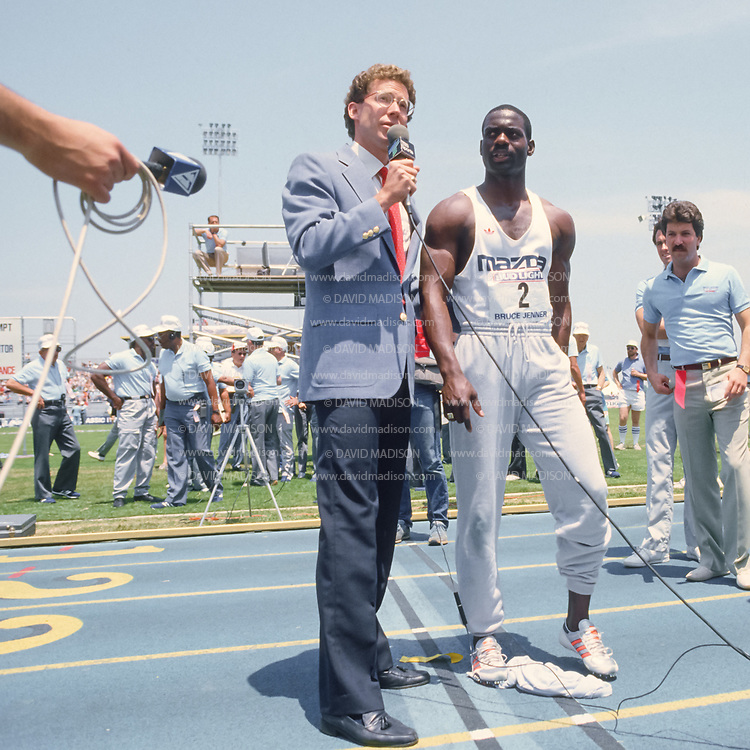 SAN JOSE, CA -  MAY 27:  Television commentator and former middle distance runner Craig Masback interviews Ben Johnson (#2) of Canada during the Bruce Jenner track meet held on May 27, 1989 at San Jose City College in San Jose, California.  (Photo by David Madison/Getty Images)